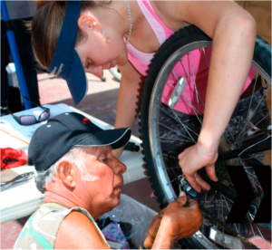 The Santa Barbara Bicycle Coalition's Bici Centro invites people from all backgrounds to learn together how to fix and maintain their bicycles for free. Photo credit: Christine Bourgeois