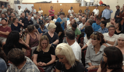 Matlock Grossman (center in blue shirt) reads his comments at the Rowena Avenue forum. Photo: Joe Linton