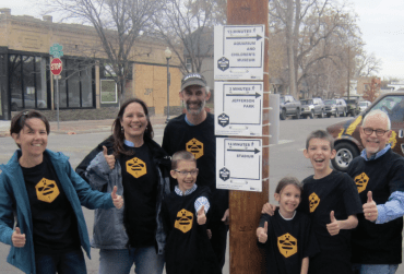 A community group in Denver, Colorado raised money to post walking directions signs advising riders of nearby destinations that are a sort distance by foot. Photo: ioby