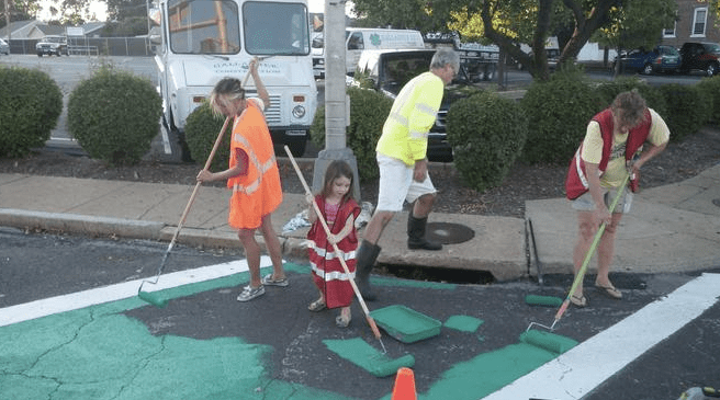 Volunteers in the Tower Grove neighborhood of St. Louis painting a crosswalk. Is this really what endangers pedestrians in St. Louis? Photo: RallySTL.org