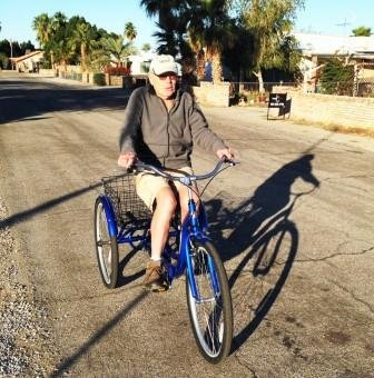 Steve, 88, of Yuma, Arizona is still able to ride his trike to the store, thanks to calm neighborhood streets. Image: Rails to Trails