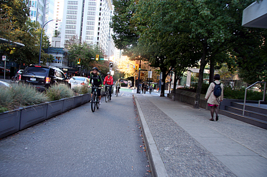 A bike lane protected from traffic by a row of planters, like this one from Vancouver, B.C., is one option being considered for 2nd and 3rd streets in Portland. Photo: Bike Portland
