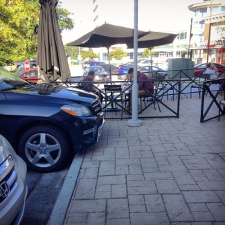In a more sprawling part of Atlanta, outdoor seating is paired uncomfortably with a parking lot. Photo: ATL Urbanist