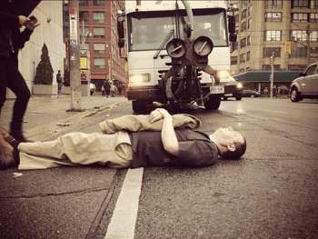 A protestor laid in the path of a machine Toronto used to erase the Jarvis Street bike lane in 2012, under Mayor Rob Ford. Photo: Spacing Toronto