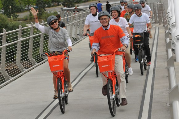 Portland Mayor Charlie Hales and his wife, Nancy, lead a celebratory bike ride over the car-free Tilikum Bride at the launch of Portland's Biketown bike share yesterday. Photo: Jonathan Maus
