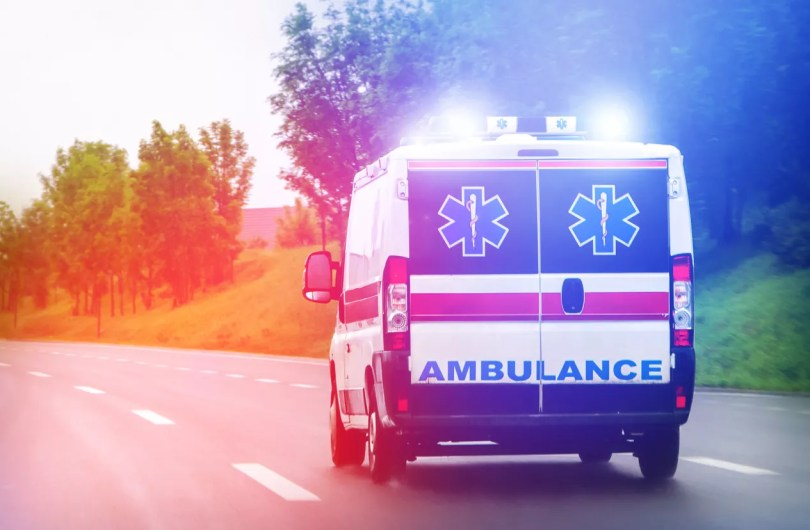 Ambulance driving on the road. Catastrophic injury lawyer.