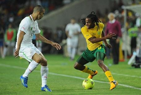 South Africa's Siphiwe Tshabalala takes on Algeria's Saad Tediar