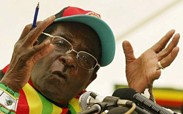 93-yrs-old President Mugabe returns to flood-wrecked Zimbabwe