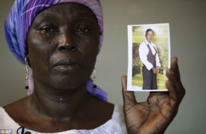 martha_mark_of-Chibok-wt-pix-of-daughter-Monica-kidnapped-by-Boko-Haram-2014