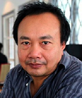 TO GO WITH: Cambodia-genocide-tribunal-UN-film-diplomacy by Rene Slama Cambodian film maker Rithy Panh poses at his office at the Audiovisual Resource Center Bophana in Phnom Penh, 09 April 2007. Cambodia's most famous filmmaker Rithy Panh, whose documentaries take an unflinching look at the legacy of the Khmer Rouge, believes the genocide trials here need a top diplomat to jump start the process. AFP PHOTO/ TANG CHHIN SOTHY (Photo credit should read TANG CHHIN SOTHY/AFP/Getty Images)