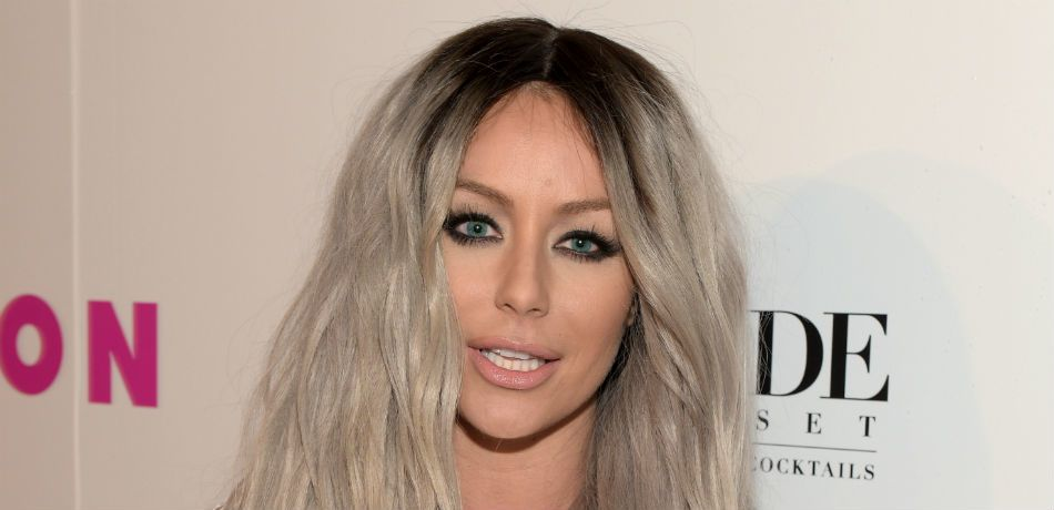 Aubrey O'Day poses at a red carpet event.