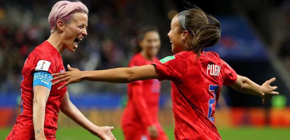 Mallory Pugh and Megan Rapinoe celebrate a goal.