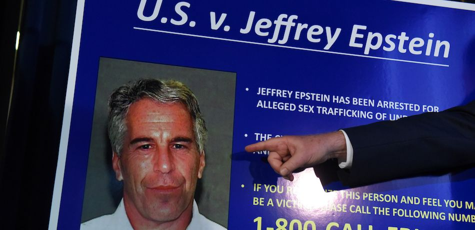 Finger points to picture of Jeffrey Epstein