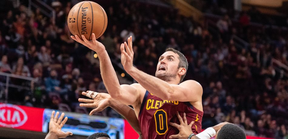 Kevin Love #0 of the Cleveland Cavaliers shoots over Alex Poythress #22 and Kent Bazemore #24 of the Atlanta Hawks during the second half at Quicken Loans Arena on October 21, 2018 in Cleveland, Ohio.