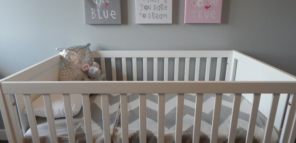 A picture of an empty baby crib.