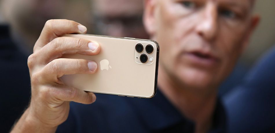 An attendee look at the new Apple iPhone 11 Pro during a special event on September 10, 2019 in the Steve Jobs Theater on Apple's Cupertino, California campus.