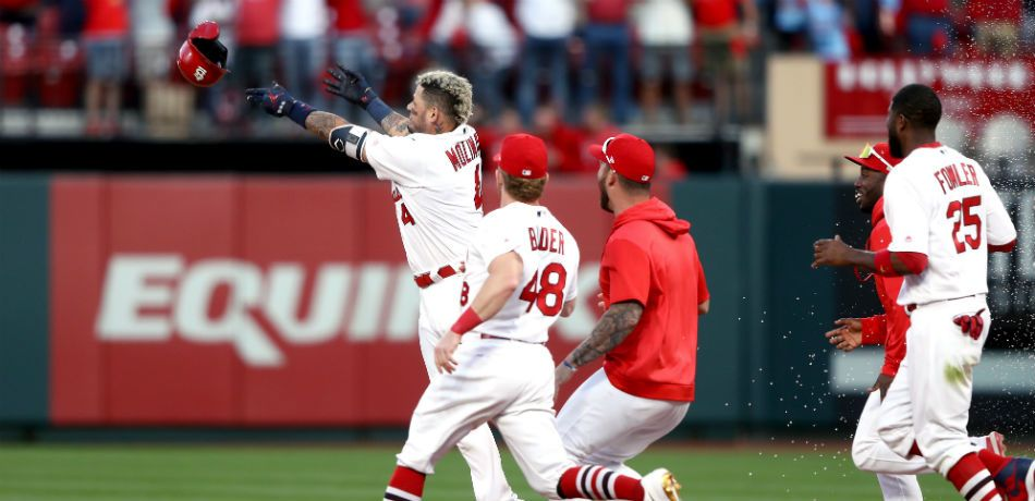 Yadier Molina #4 of the St. Louis Cardinals hits a walk-off sacrifice fly to give his team the 5-4 win over the Atlanta Braves in game four of the National League Division Series at Busch Stadium on October 07, 2019 in St Louis, Missouri.