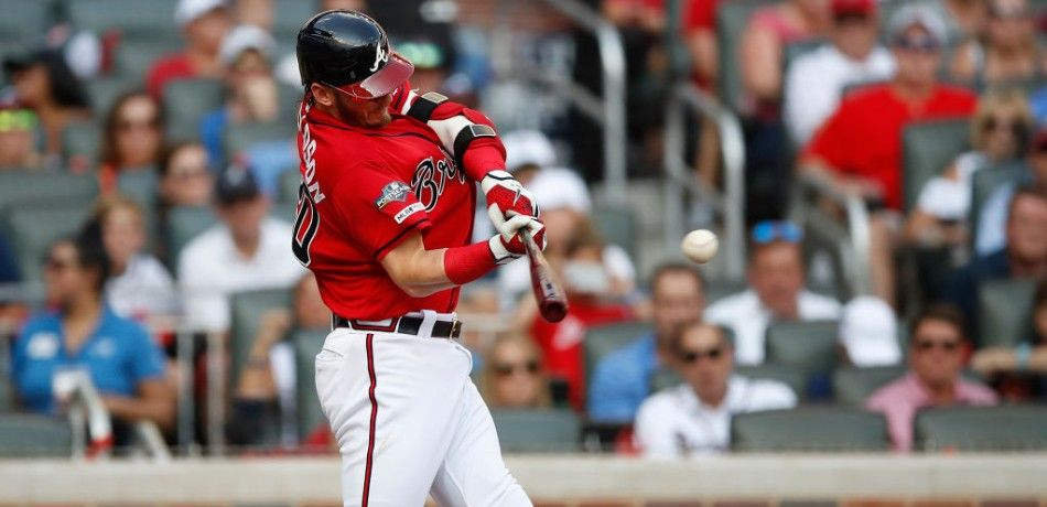 Josh Donaldson of the Atlanta Braves hits an RBI single during the 2019 NL Division Series.