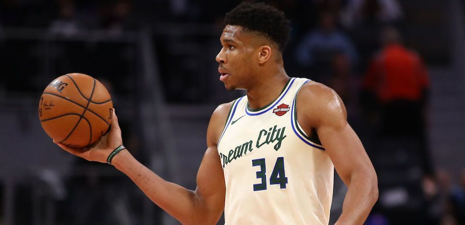 Giannis Antetokounmpo of the Milwaukee Bucks handles the ball during a game against the Detroit Pistons.