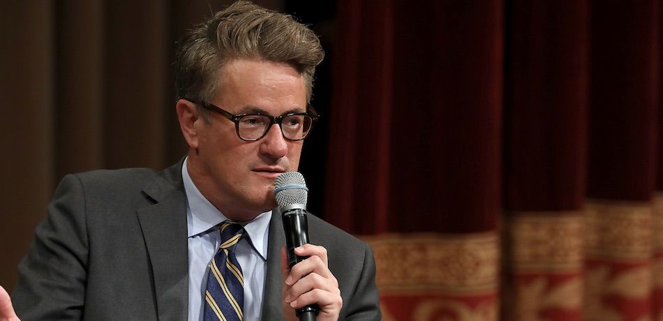 MSNBC 'Morning Joe' host Joe Scarborough speaks during an interview with his co-host Mika Brzezinski and philanthropist and financier David Rubenstein during a Harvard Kennedy School Institute of Politics event in the McGowan Theater at the National Archives July 12, 2017 in Washington, DC.
