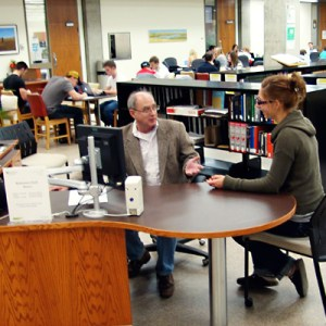 Chris Adams sees hundreds of students at the reference desk in Murray Memorial Library.