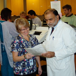 Jay Kalra (right) in the pathology lab at Royal University Hospital.