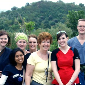 Susan Fowler-Kerry (centre) and nursing students in the Phillipines.