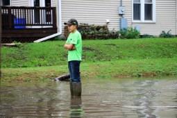 Young Boy Overlooks the Cedar River Flooding www.usathroughoureyes.com