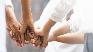 Empowerment Through Partnership- Spread Wide To Aim High