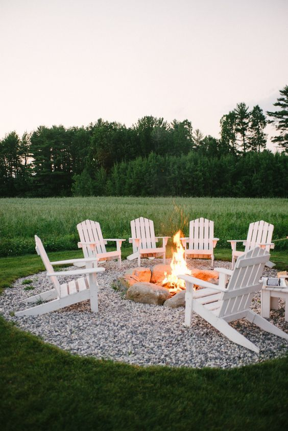 Top 50 diy fire pit ideas to warm your summer nights useful diy use river rocks and a gravel zone to form your fire pit zone surrounded by elegant white wooden furniture solutioingenieria Choice Image