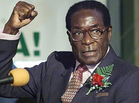 "Zimababwe's President Robert Mugabe chants Zanu PF slogans with supporters gathered at the Harare International Conference Centre in Harare, Wednesday May 3, 2000. Mugabe launched the Zanu PF's election manifesto which bears the slogan ""Land is the Economy and the Economy is Land"". (AP Photo/Christine Nesbitt)"