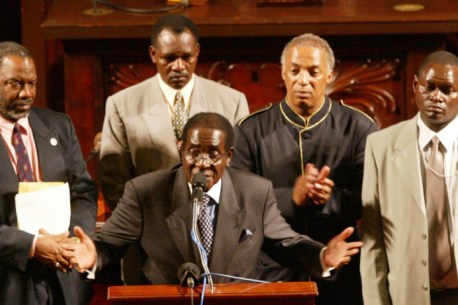 9.12.02   Zimbabwean President Robert Mugabe speaks at the podium in the City Council Chamber of City Hall.
