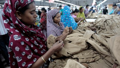 Women work at a garment factory in Savar July 27, 2012. Women work for ten hours a day and earn about 3,000 taka ($37.5) per month. Bangladesh's $19 billion garments industry attracts some of the world's biggest clothing brands because of low costs, but many retailers say unrest over pay and delayed shipping schedules are eroding that advantage. Picture taken on July 27, 2012. To go with story BANGLADESH-GARMENTS/   REUTERS/Andrew Biraj (BANGLADESH - Tags: SOCIETY POVERTY BUSINESS EMPLOYMENT) - RTR37L3S