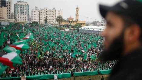 Supporters listen as Ismail Haniyeh, prime minister of the Hamas Gaza government, speaks during a Hamas rally marking the anniversary of the death of its leaders killed by Israel, in Gaza City March 23, 2014. REUTERS/Mohammed Salem (GAZA - Tags: POLITICS CIVIL UNREST ANNIVERSARY)