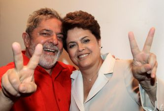 In this photo provided by Brazil's Presidency, Brazil's President Luiz Inacio Lula da Silva, left, and Brazil's newly elected leader Dilma Rousseff, make a sign of victory, at the Alvorada palace, in Brasilia, Brazil, Monday, Nov. 1, 2010. (AP Photo/Brazil's Presidency, Ricardo Stuckert) NO SALES
