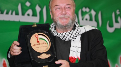 epa02375994 British PM George Galloway poses with a gift he received during his reception at the Arab Cultural Center in the Yarmouk refugee camp near Damascus, Syria, 05 October 2010. Galloway leads the Gaza-bound Viva Palestina 5 aid convoy that arrived in Damascus on 02 October from Turkey. The convoy includes 143 trucks loaded with medical and humanitarian aids and 370 Arab and foreign activists. Galloway said he is determined to go on with his aid convoy to Palestinians under Israeli siege despite the Egyptian authorities' decision to ban his entry to Egypt. EPA/YOUSSEF BADAWI