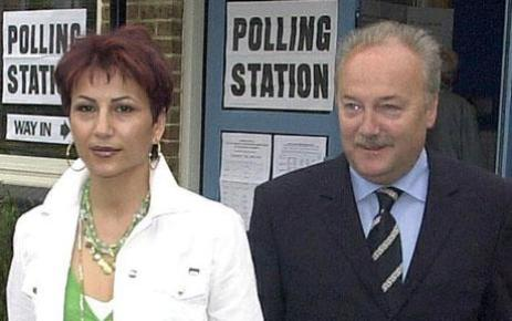 George Galloway - Elections...George Galloway with his wife Amineh after voting at Streatham in the in Local Goverment elections,London Mayoral election and European Parliamentary Elections. ... George Galloway - Elections ... 10-06-2004 ... LONDON ... UK ... PRESS ASSOCIATION photo. Photo credit should read: Michael Stephens/PA Archive. Unique Reference No. 1968245 ...