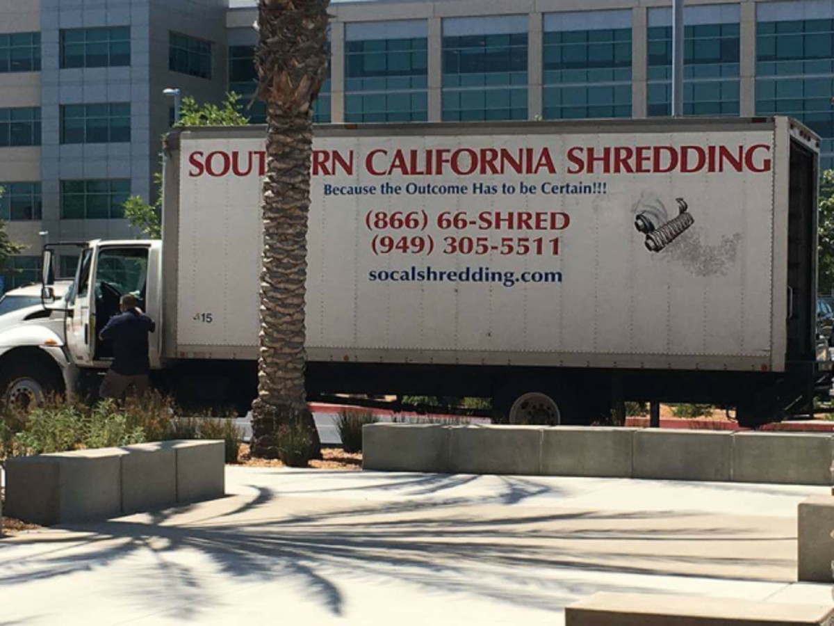Shredding machine truck seen parked in lot of San Diego vote-counting center.