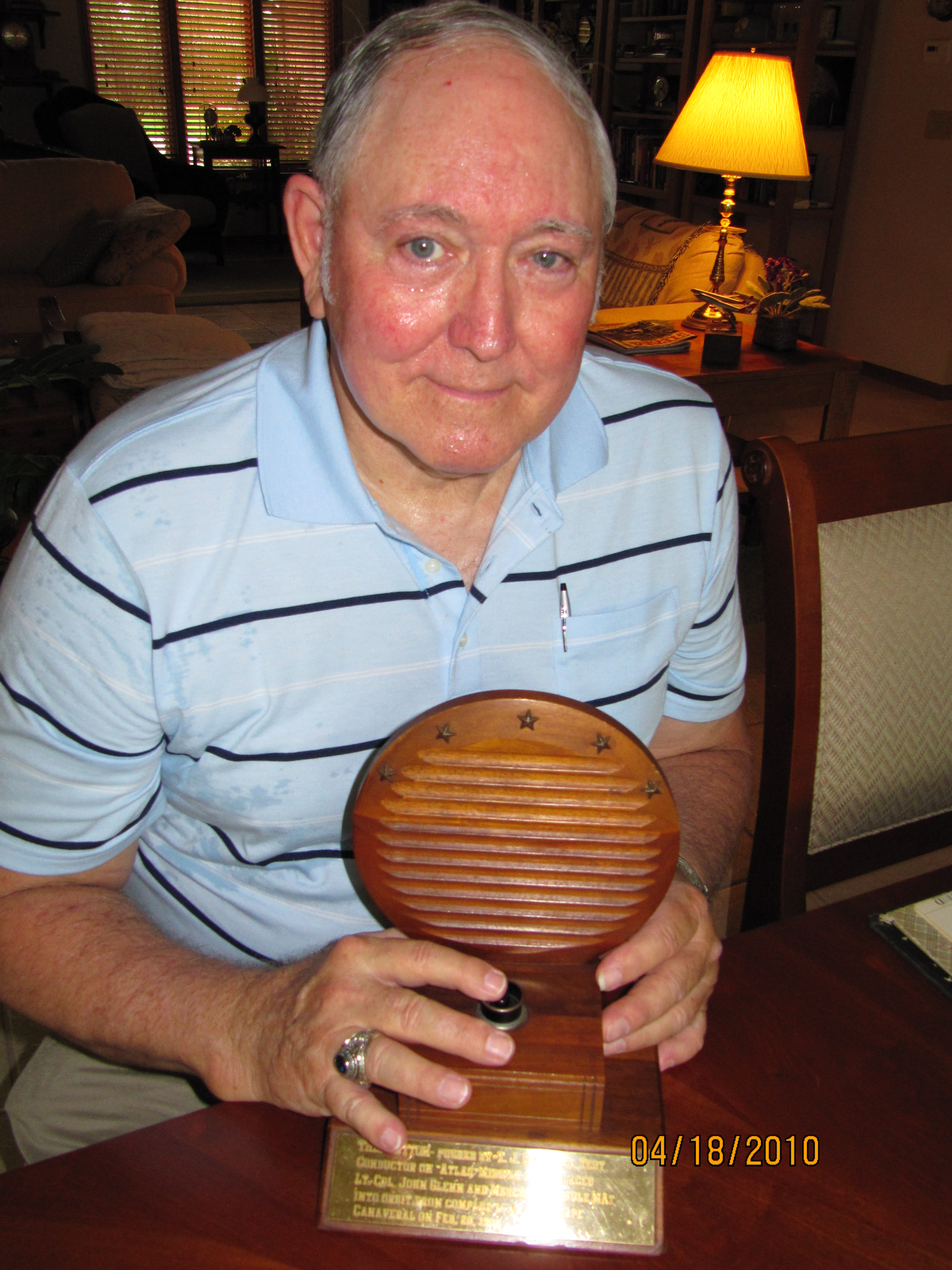 Jim pushing the John Glenn button just before it was donated to a NASA museum. The trophy was donated by T.J.s wife Anne after his passing in 2009.