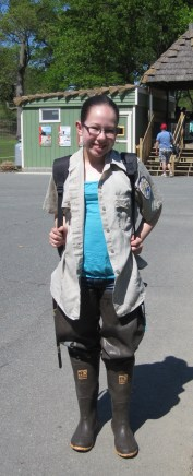 Eleven-year old Kaela Heitkamp is ready to hit the swamp in the biologist shirt and waders! Credit: USFWS