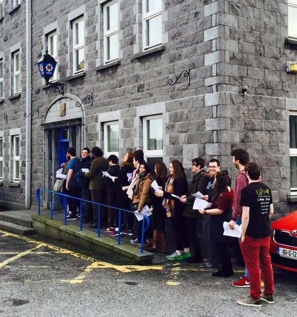Queues of Students gather outside Garda stations across Ireland to Register to Vote before General Election