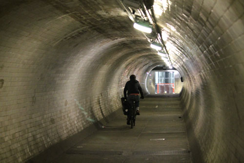 Surely that's not a cyclist riding through the tunnel?