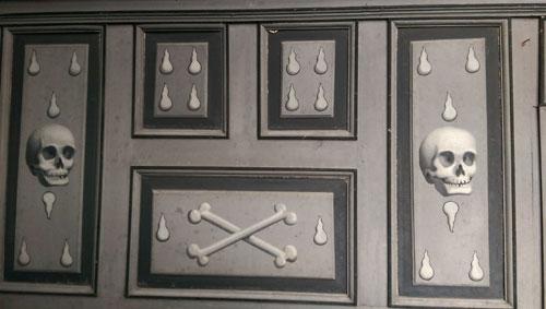 Strange memento mori wall decorations at the Chateau