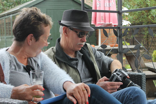 In the beer garden, Glenn reviews his photos from the last ten years