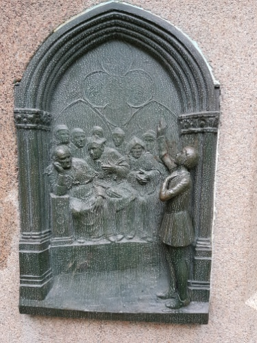 Relief showing Joan defending herself