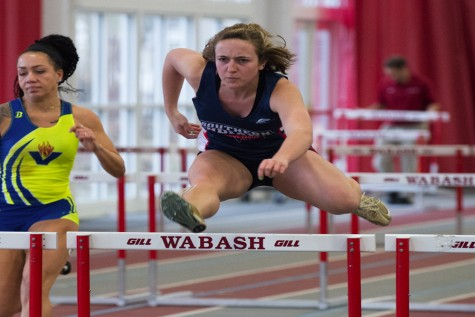 Sophomore sprinter Jenna Martin clears a hurdle at the University of Indianapolis Collegiate Invitational January 23. Martin set a new school record in the 60-meter hurdles two meets later.