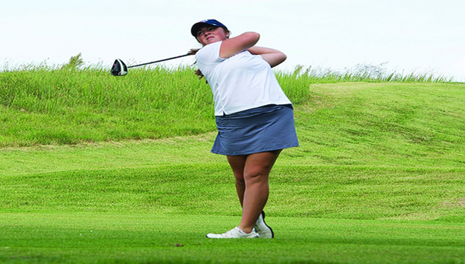 Junior+Taylor+Howerton+follows+through+with+her+swing+during+the+Screaming+Eagles+Golf+Classic+in+September.+Howerton+transfered+to+the+university+to+compete+in+the+2016+season+after+spending+her+freshman+year+at+Indiana+University.+