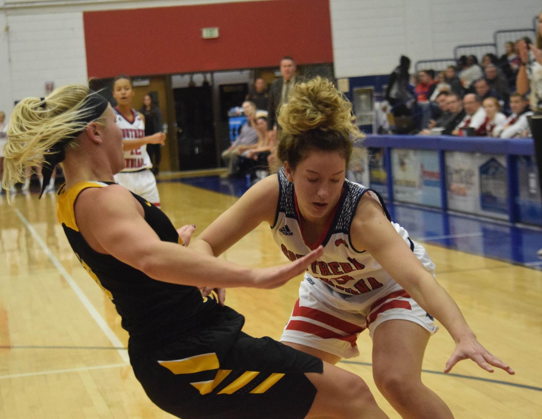 Emma+DeHart%2C+freshman+guard%2C+drives+to+the+basket.