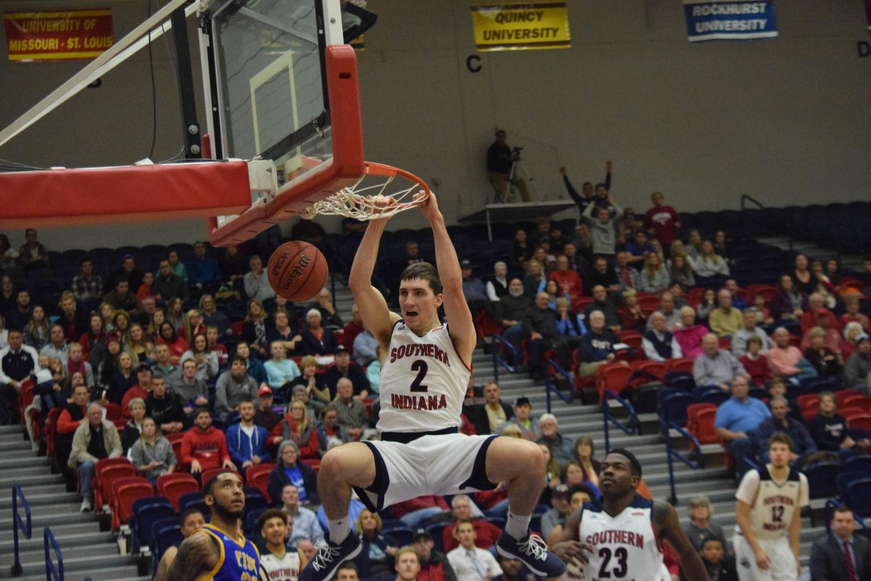 acob+Norman%2C+junior+forward%2C+dunks+the+ball+against+Fisk+University.