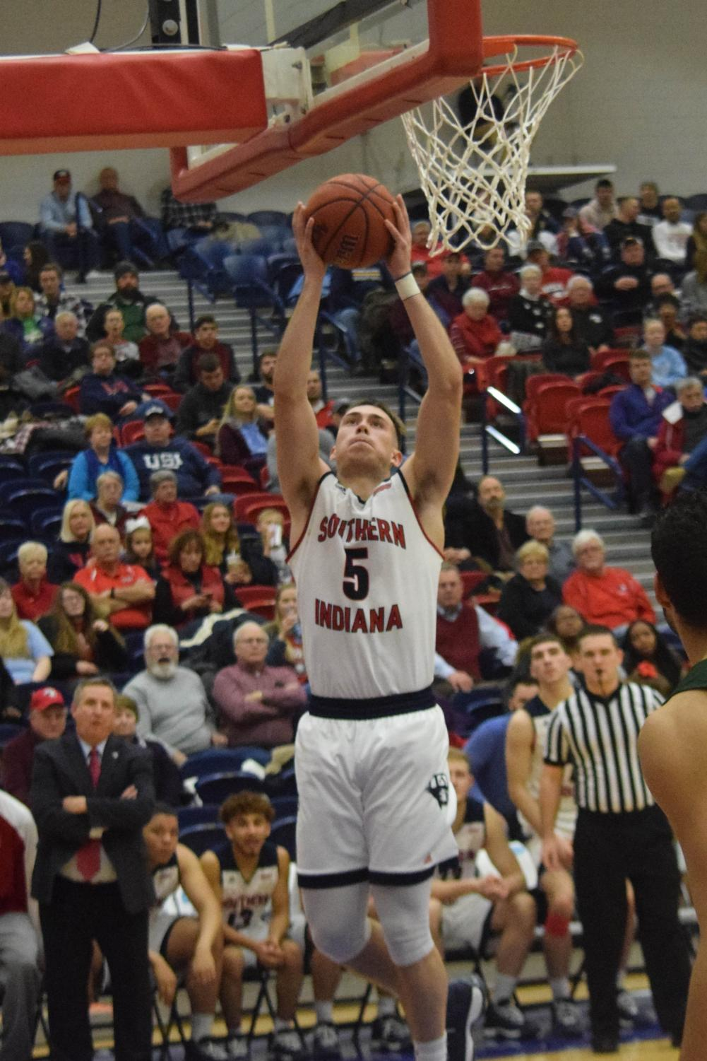 Nate+Hansen%2C+junior+guard%2C+gets+to+the+basket+for+a+layup.